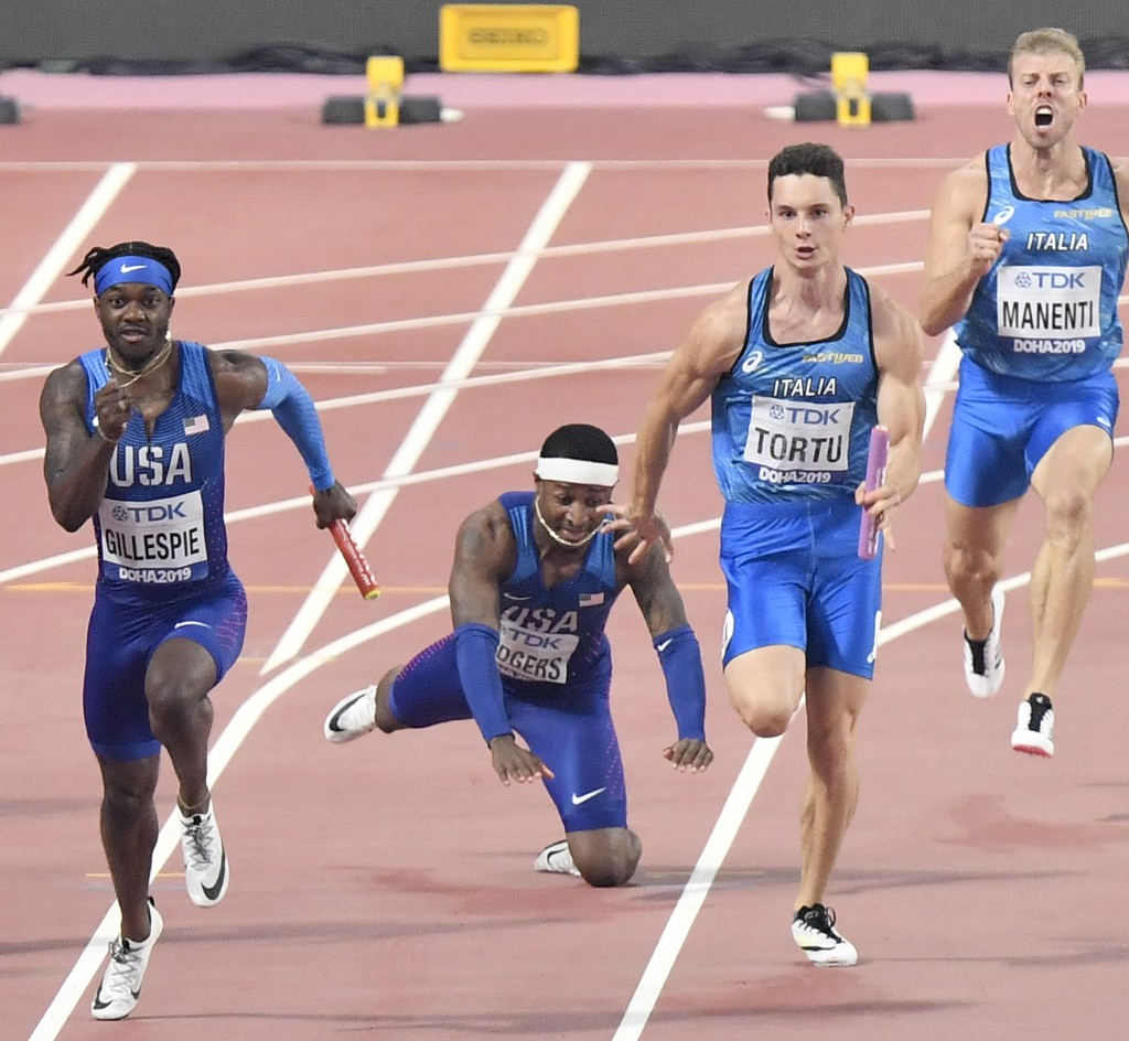 Unites States' Michael Rodgers falls, after relaying with Cravon Gillespie, left, as Italy's Davide Manenti, right screaming, and Filippo Tortu, secon
