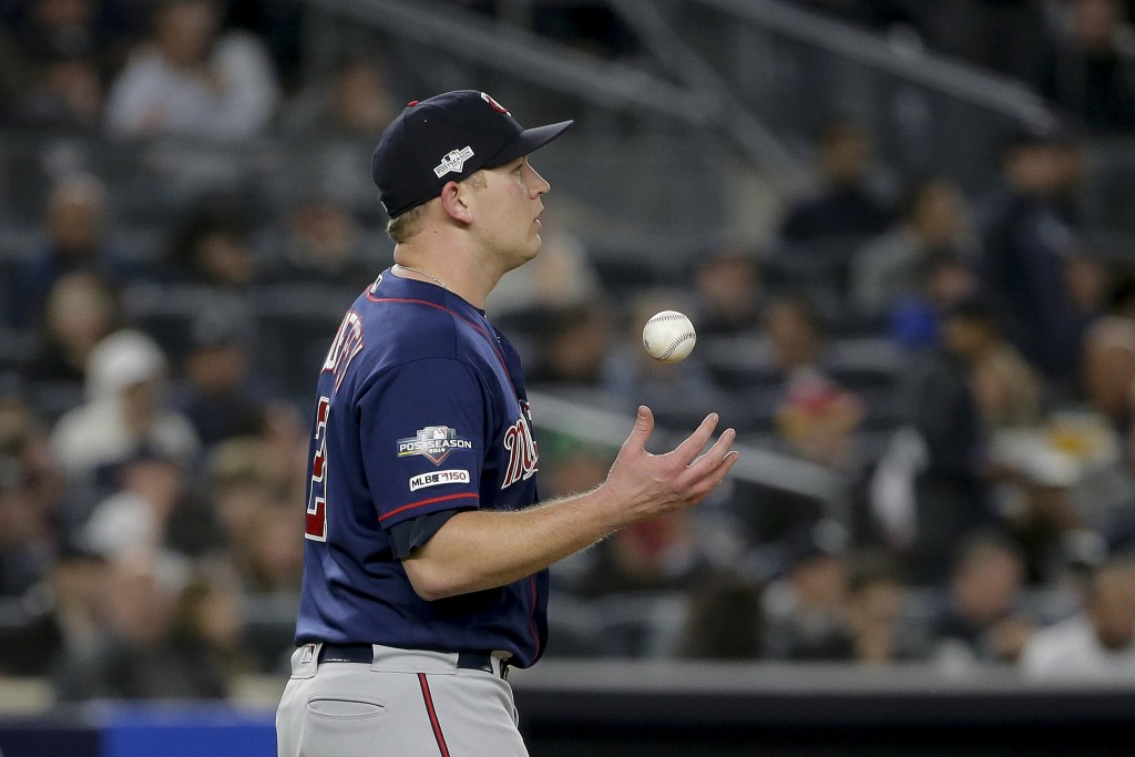 Minnesota Twins relief pitcher Tyler Duffey (21) flips the ball during the fifth inning of Game 1 of an American League Division Series baseball game ...