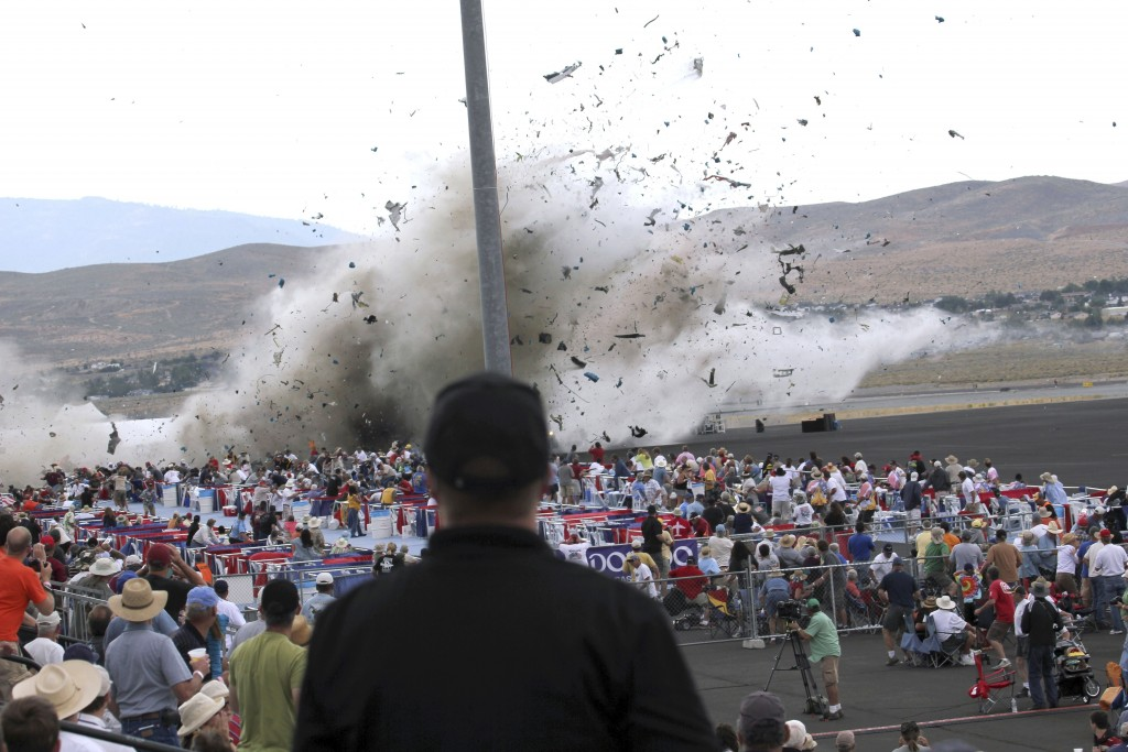 FILE - In this Sept. 16, 2011, file photo, a P-51 Mustang airplane crashes into the edge of the grandstands at the Reno Air show in Reno, Nev. The fat