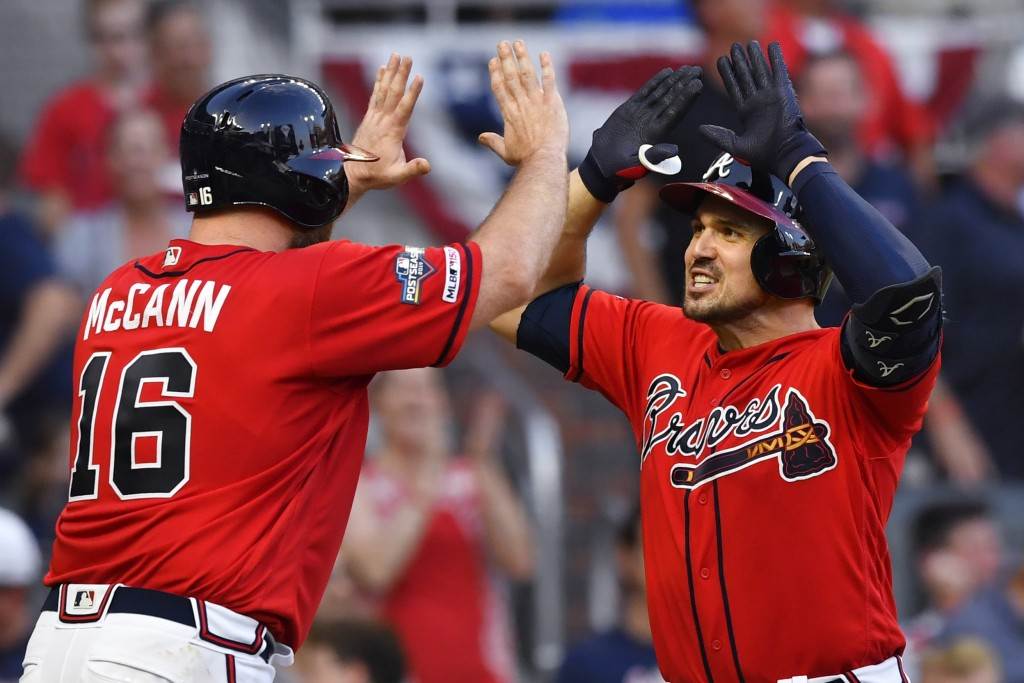 Atlanta Braves Adam Duvall (23) is congratulated by Atlanta Braves Brian McCann (16) after Duvall's two-run homer against the St. Louis Cardinals in t...