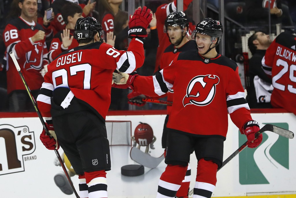 New Jersey Devils left wing Nikita Gusev (97) celebrates with left wing Jesper Bratt after scoring against the Winnipeg Jets during the first period o...