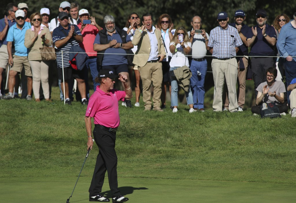 Spanish golf player Miguel Angel Jimenez competes during the second round of the Spanish Open golf tournament in Madrid, Spain, Friday, Oct. 4, 2019. ...