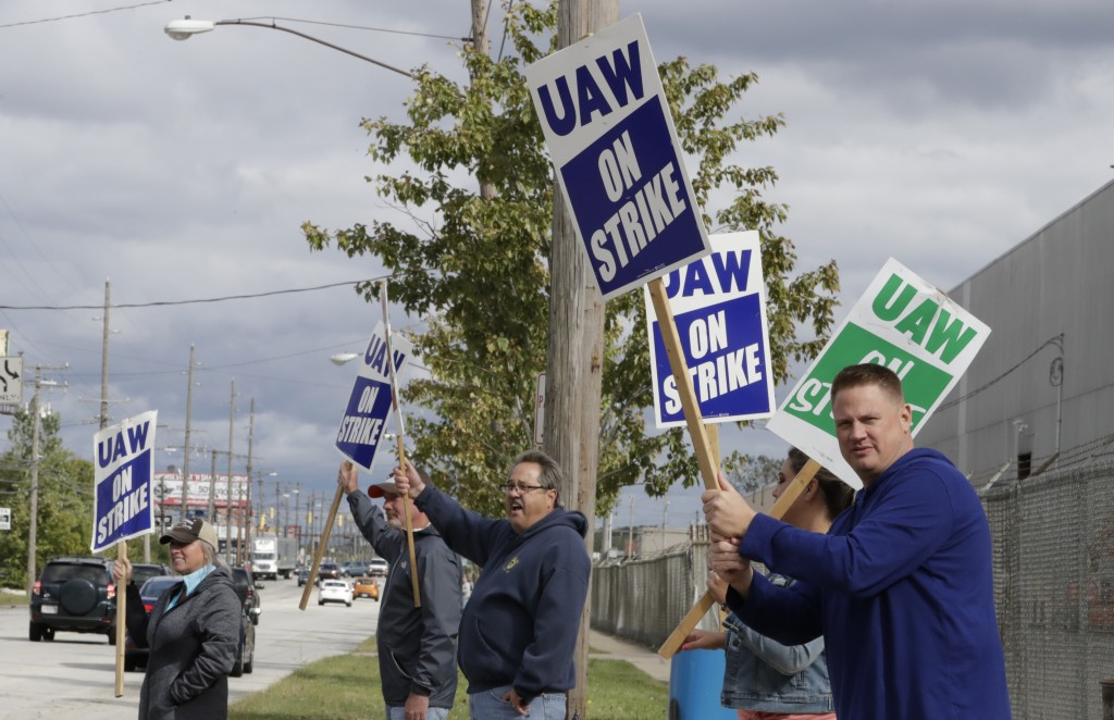 Charlie Illig, a 22-year GM employee, pickets along with co-workers outside the General Motors Fabrication Division, Friday, Oct. 4, 2019, in Parma, O...