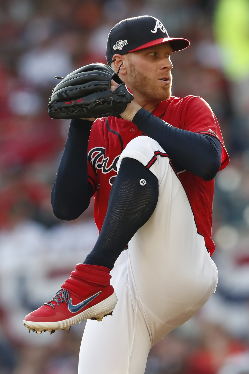 Atlanta Braves starting pitcher Mike Foltynewicz (26) works in the fifth inning during Game 2 of a best-of-five National League Division Series, Frida...
