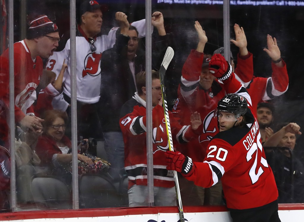 New Jersey Devils center Blake Coleman (20) celebrates after scoring a goal against the Winnipeg Jets during the second period of an NHL hockey game F...