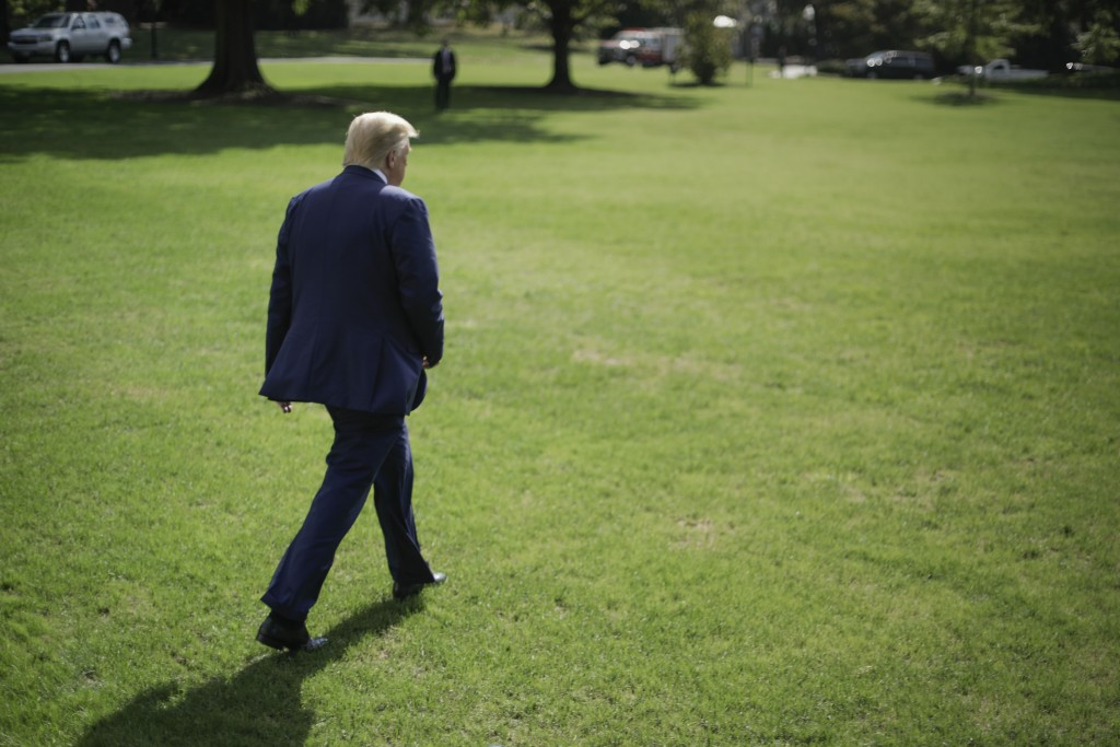 President Donald Trump walks across the South Lawn of the White House in Washington, Friday, Oct. 4, 2019, before boarding Marine One helicopter for t...