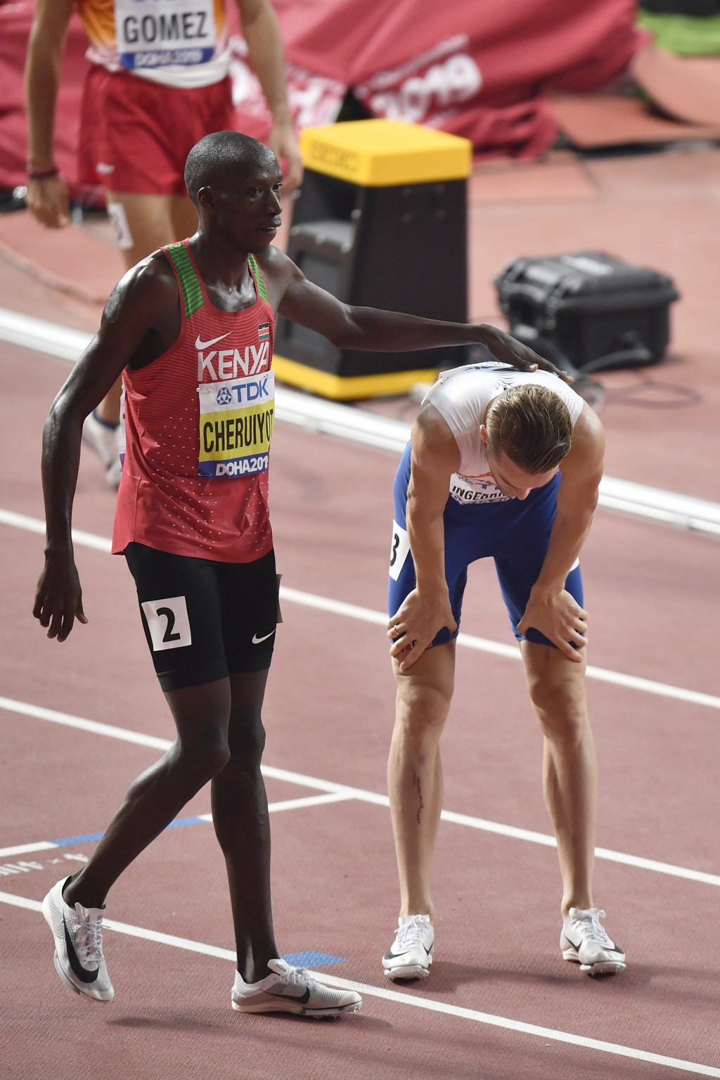 Timothy Cheruiyot, of Kenya, consoles Filip Ingebrigtsen, of Norway, right, after the men's 1500 meter semifinal at the World Athletics Championships ...