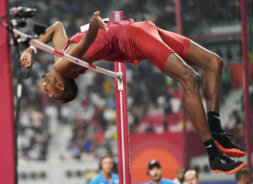 Gold medalist Mutaz Essa Barshim, of Qatar, competes in the men's high jump final at the World Athletics Championships in Doha, Qatar, Friday, Oct. 4,...