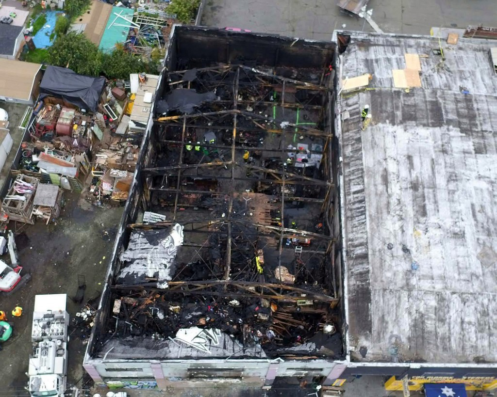 FILE - This undated file photo provided by the City of Oakland shows the burned warehouse after the deadly fire that broke out on Dec. 2, 2016, in Oak...