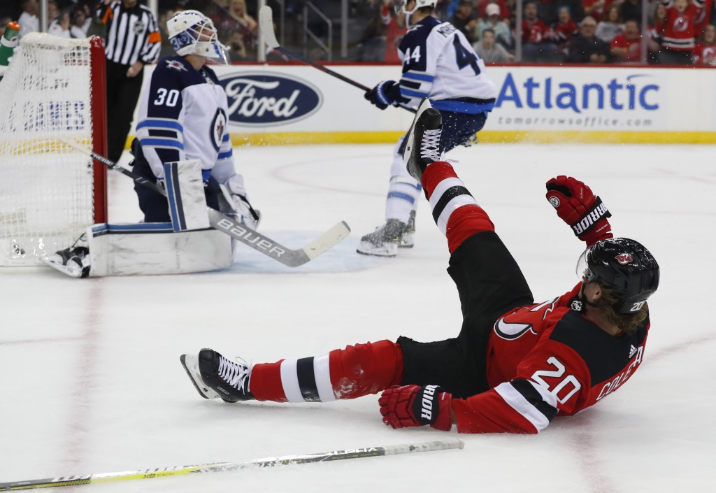 Winnipeg Jets goaltender Laurent Brossoit (30) reacts after a goal scored by New Jersey Devils center Blake Coleman (20) during the second period of a