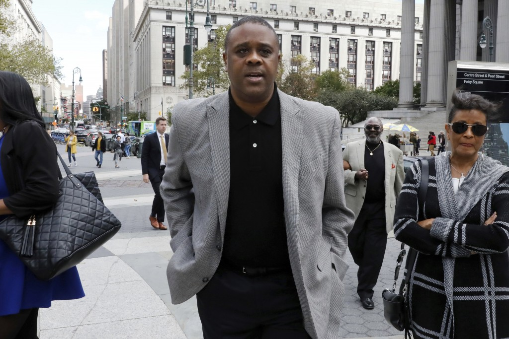 Former amateur basketball league director Merl Code leaves federal court after sentencing, Friday, Oct. 4, 2019, in New York. Code was sentenced to th