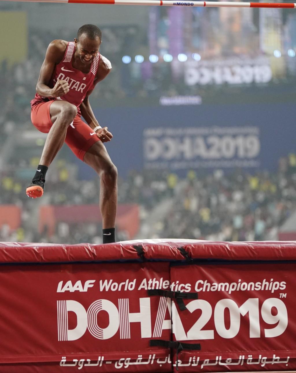 Gold medalist Mutaz Essa Barshim, of Qatar, celebrates after the men's high jump final at the World Athletics Championships in Doha, Qatar, Friday, Oc...