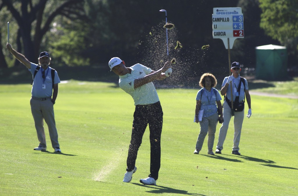 Chinese golfer Haotong Li competes during the second round of the Spanish Open golf tournament in Madrid, Spain, Friday, Oct. 4, 2019. (AP Photo/Tales