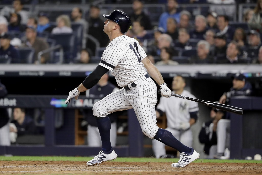 New York Yankees left fielder Brett Gardner (11) watches his solo home run sail into the right field seats during the sixth inning of Game 1 of an Ame...