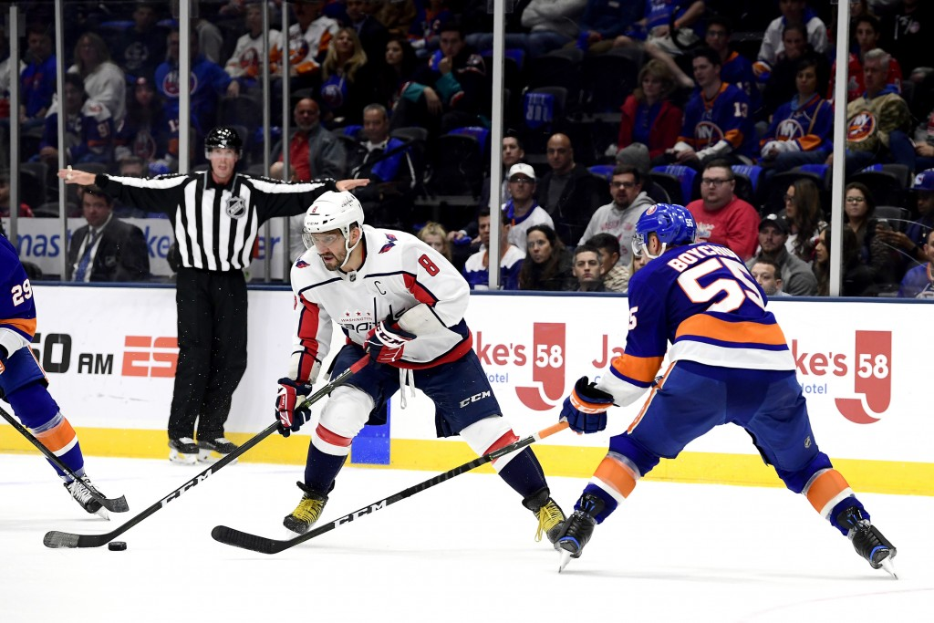 Washington Capitals left wing Alex Ovechkin (8) is defended by New York Islanders defenseman Johnny Boychuk (55), during the first period of an NHL ho