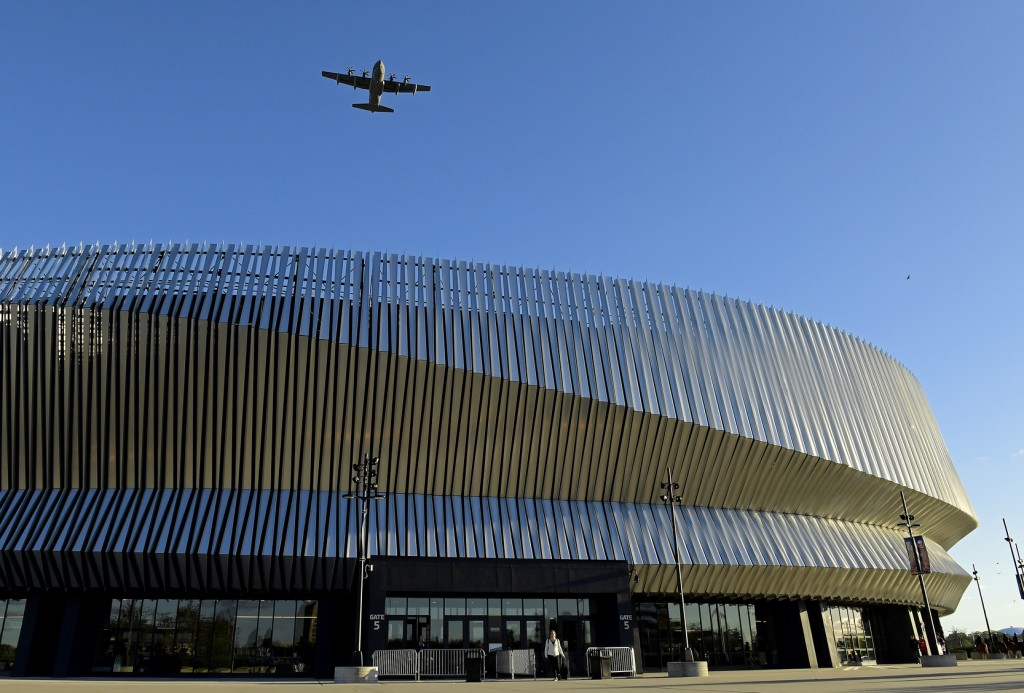 A military aircraft, based out of the Westhampton Beach 106th Rescue Wing, flies over Nassau Coliseum prior to an NHL hockey game between the New York