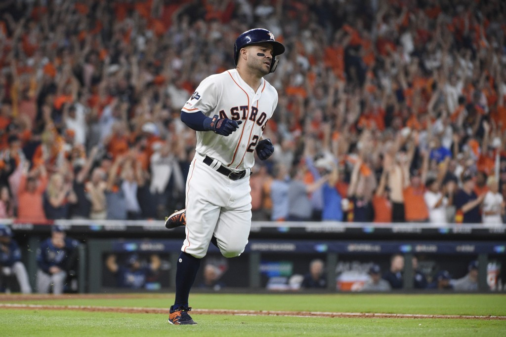 Houston Astros' Jose Altuve (27) rounds the bases after hitting a two-run home run against the Tampa Bay Rays in the fifth inning during Game 1 in bas