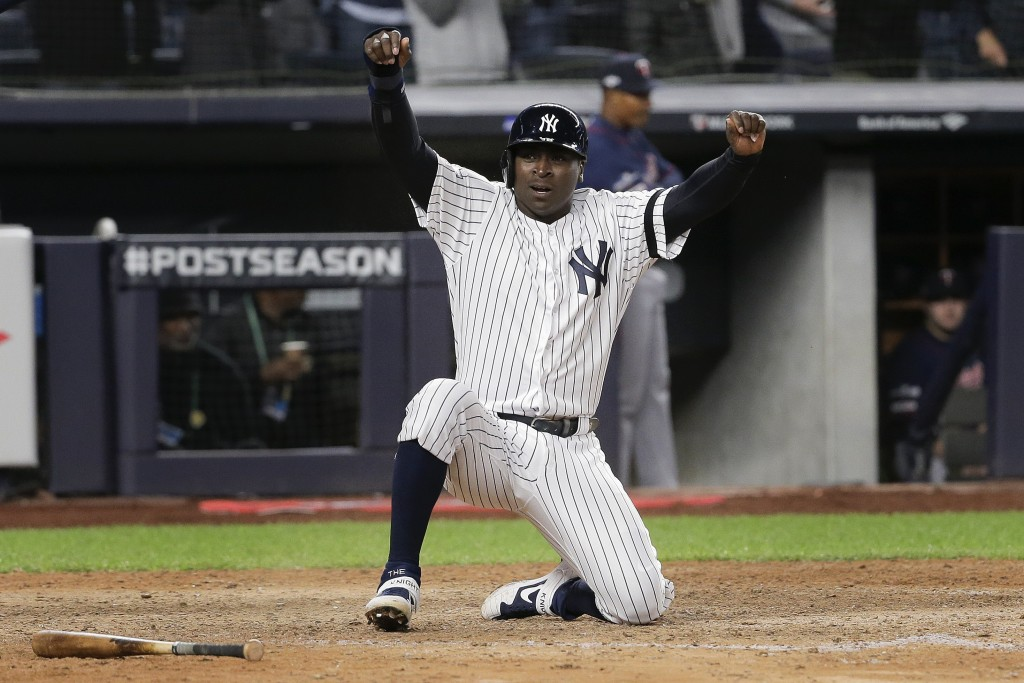 New York Yankees' Didi Gregorius reacts after scoring on a double by second baseman DJ LeMahieu (26) during the seventh inning of Game 1 of an America