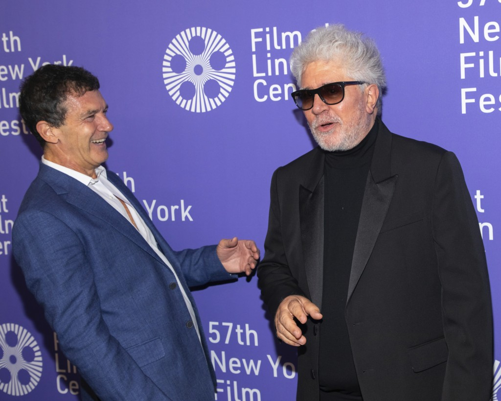 """FILE - This Sept. 28, 2019 file photo shows actor Antonio Banderas, left, and director/screenwriter Pedro Almodovar at the premiere of """"Pain and Glory"""