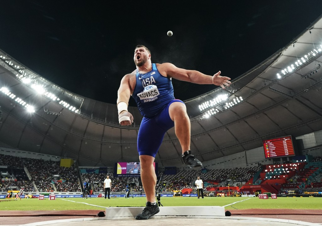 Joe Kovacs, of the United States, competes in the men's shot put final to win the championship record for gold at the World Athletics Championships in...