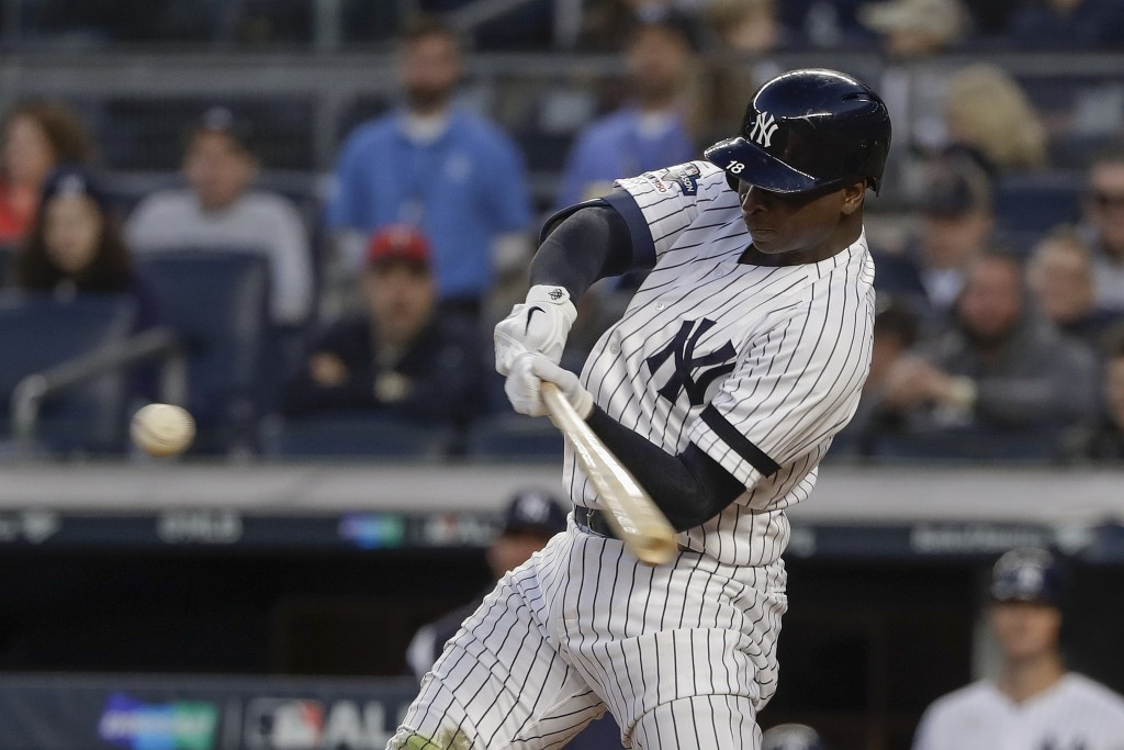 New York Yankees shortstop Didi Gregorius (18) connects for a grand slam home run against the Minnesota Twins during the third inning of Game 2 of an ...