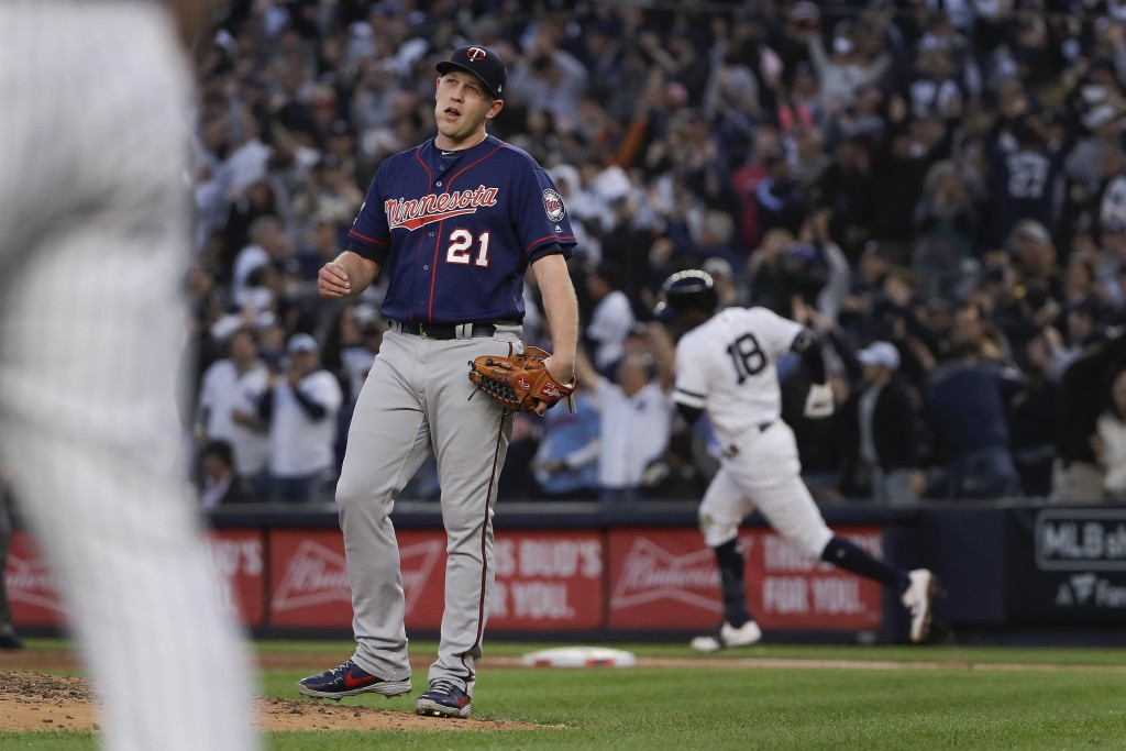 Minnesota Twins relief pitcher Tyler Duffey (21) reacts after giving up a grand slam home run to New York Yankees' Didi Gregorius during the third inn...