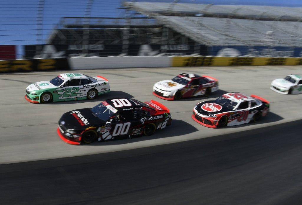 Pole setter Austin Cindric (#22) next to driver Cole Custer (#00) leads the field at the start of the  NASCAR Xfinity Series auto race, Saturday, Oct.