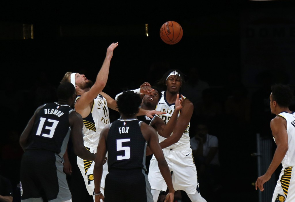 Players from Sacramento Kings, in blue, and Indiana Pacers vie for the ball during the NBA India Games 2019, in Mumbai, India, Saturday, Oct. 5, 2019....