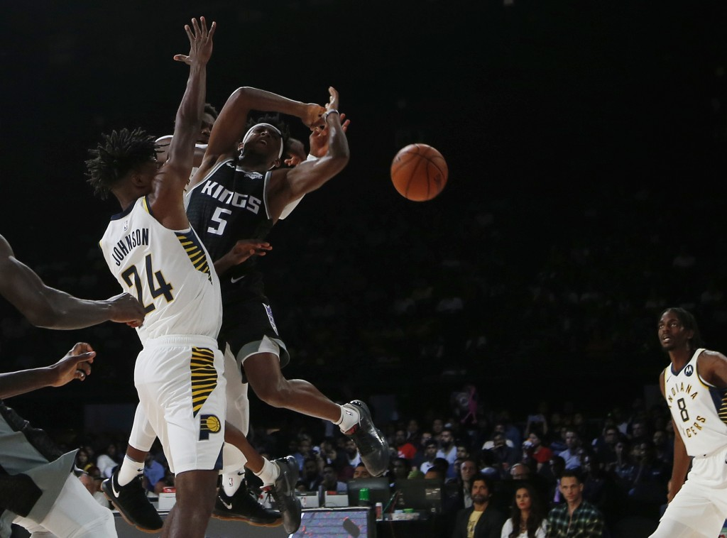 Sacramento Kings player De' Aaron Fox plays against Indiana Pacers during the NBA India Games 2019, in Mumbai, India, Saturday, Oct. 5, 2019. (AP Phot...