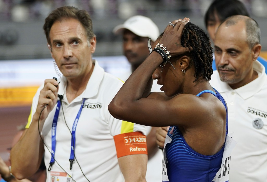 Brianna McNeal, of the United States reacts after being disqualified for a false start in a women's 100 meter hurdles heat at the World Athletics Cham