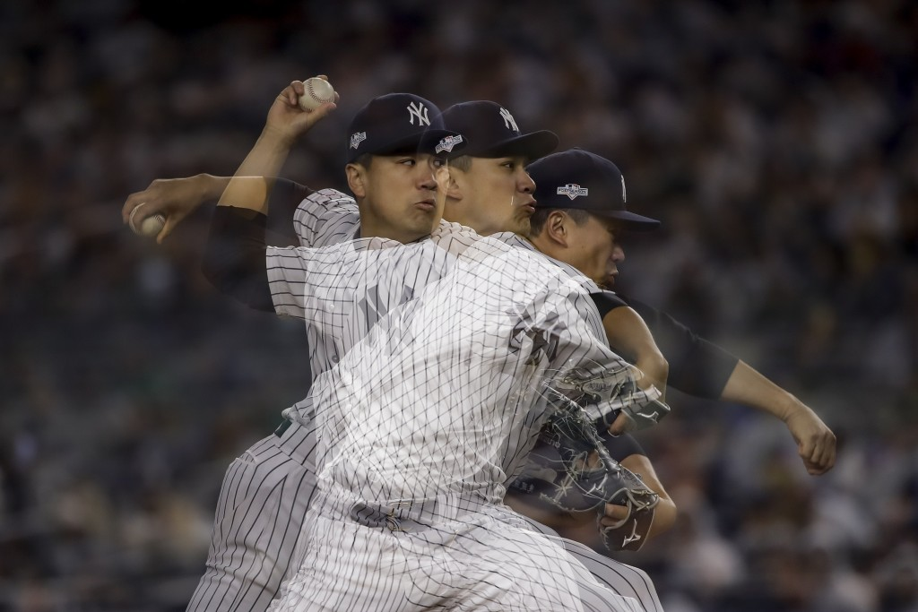 In this multiple exposure image, New York Yankees starting pitcher Masahiro Tanaka delivers against the Minnesota Twins during the fifth inning of Gam...