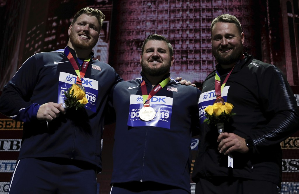 Joe Kovacs, of the United States, gold, Ryan Crouser, of the United States, silver, and Tomas Walsh, of New Zealand, bronze, during the medal ceremony