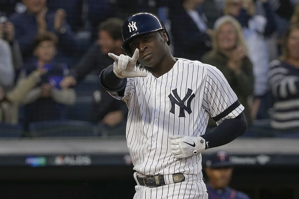 New York Yankees' Didi Gregorius motions as he crosses the plate after hitting a grand slam home run against the Minnesota Twins during the third inni...