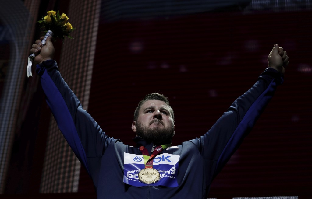 Joe Kovacs, of the United States, gold, during the medal ceremony for the men's shot put final at the World Athletics Championships in Doha, Qatar, Sa...