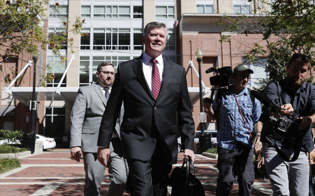 Kevin Downing, center, an attorney representing two Florida businessmen Lev Parnas and Igor Fruman, arrives at the federal courthouse in Alexandria, V