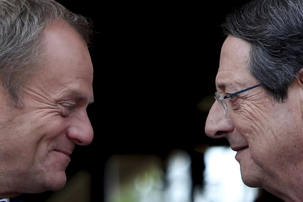 Cyprus' President Nicos Anastasiades, right, talks with European Council President Donald Tusk as he arrives for a meeting at the presidential palace