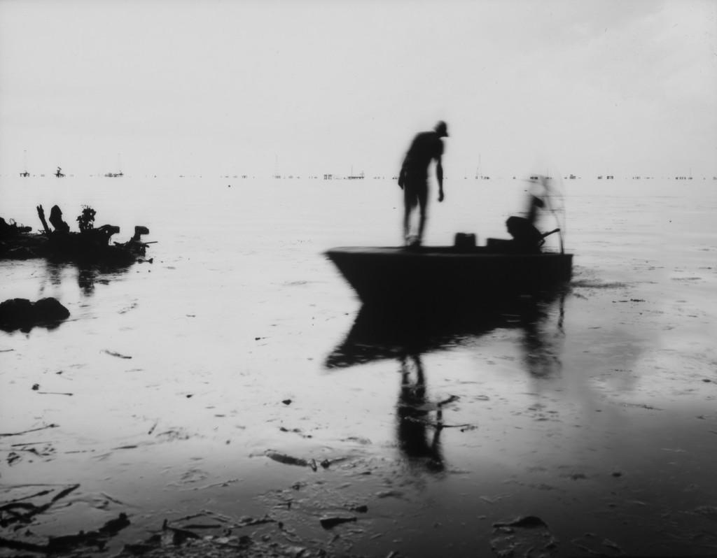 Fishermen get ready to start harvesting crabs in the oil-contaminated Lake Maracaibo near Cabimas, Venezuela, July 5, 2019. (AP Photo/Rodrigo Abd)