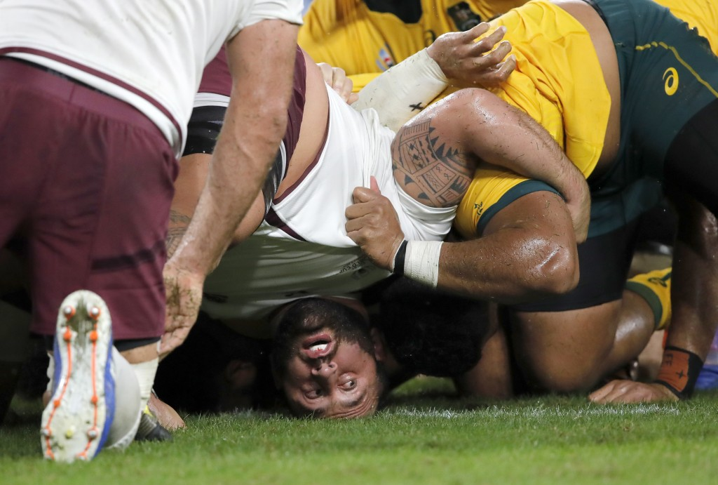 Georgia's Beka Gigashvili reacts as a scrum collapses to the ground during the Rugby World Cup Pool D game at Shizuoka Stadium Ecopa between Australia...