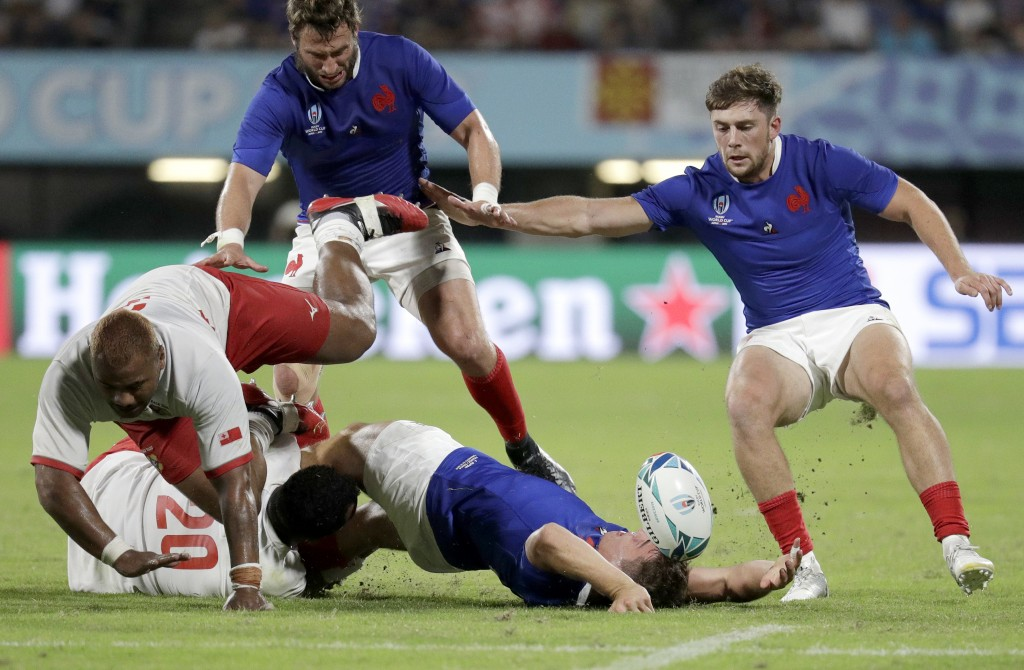 France's Antoine Dupont loses the ball in a tackle during the Rugby World Cup Pool C game at Kumamoto Stadium between France and Tonga in Kumamoto, Ja...