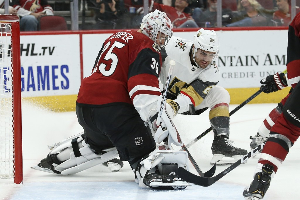 Arizona Coyotes goaltender Darcy Kuemper (35) makes a save on a shot by Vegas Golden Knights left wing William Carrier (28) during the second period o