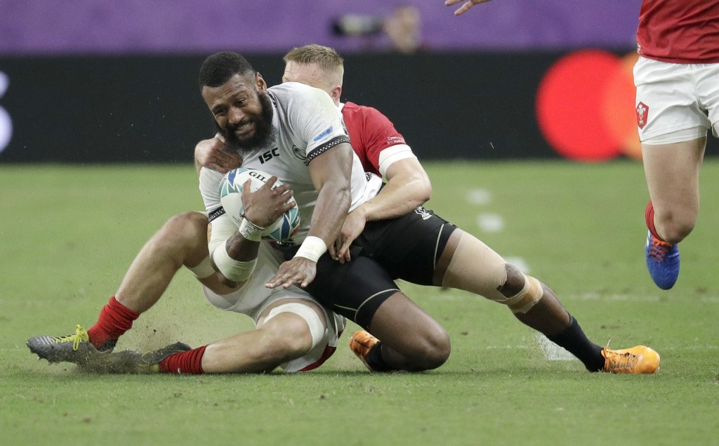Fiji's Waisea Nayacalevu is tackled during the Rugby World Cup Pool D game at Oita Stadium between Wales and Fiji in Oita, Japan, Wednesday, Oct. 9, 2...