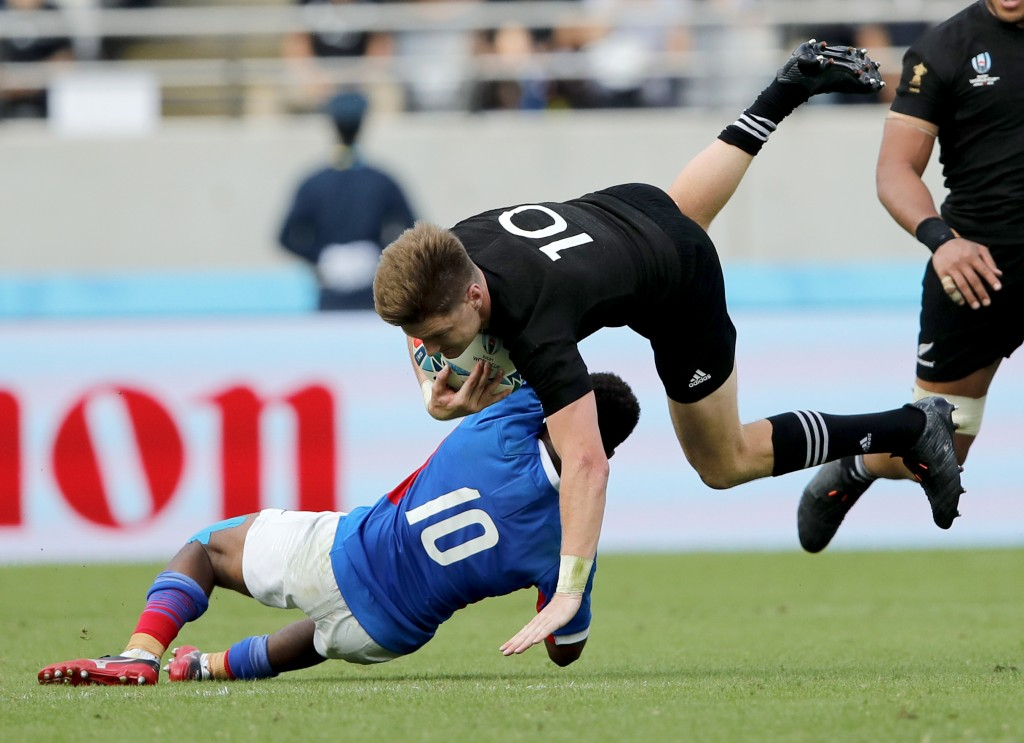 New Zealand's Jordie Barrett is tackled by Namibia's Helarius Kisting during the Rugby World Cup Pool B game at Tokyo Stadium between New Zealand and ...
