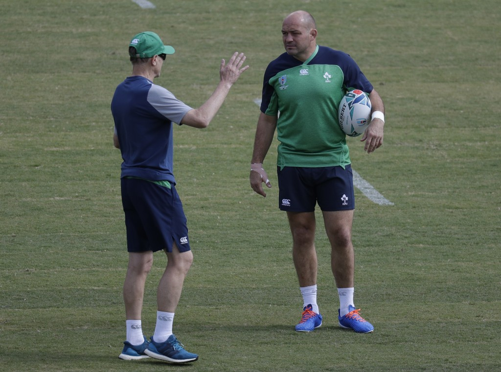 Ireland rugby team captain Rory Best, right, talks with coach Joe Schmidt during training for their their Rugby World Cup Pool A game at the Fukuoka H...