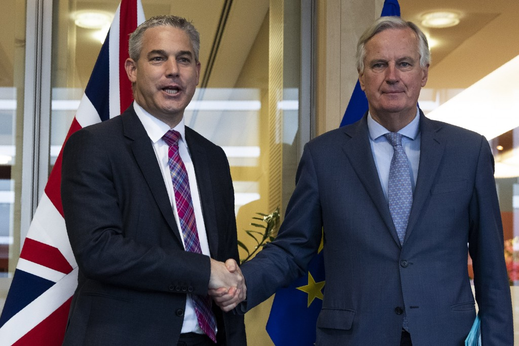 UK Brexit secretary Stephen Barclay, left, shakes hands with European Union chief Brexit negotiator Michel Barnier before their meeting at the Europea...
