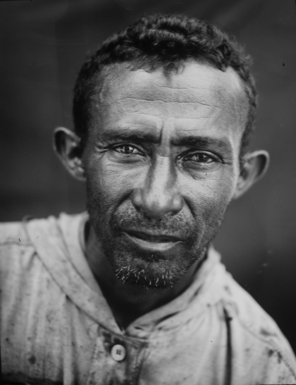 Fisherman Juzman Garcia poses for a portrait after his workday on oil-contaminated Lake Maracaibo in Cabimas, Venezuela, July 3, 2019. (AP Photo/Rodri