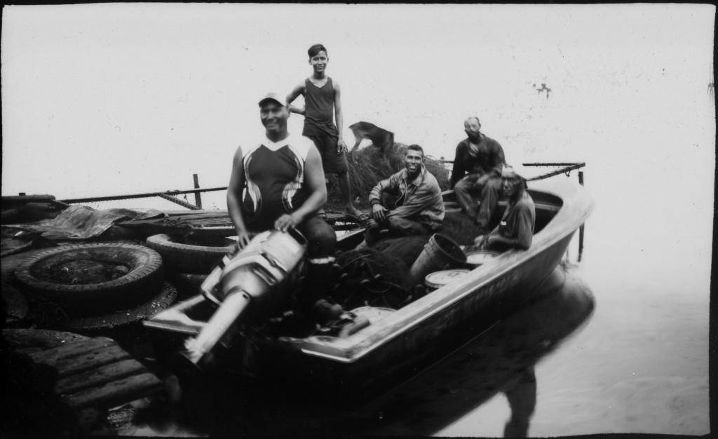 Fishermen pose for a photo before crab fishing in the oil-contaminated Lake Maracaibo near Cabimas, Venezuela, July 5, 2019. (AP Photo/Rodrigo Abd)