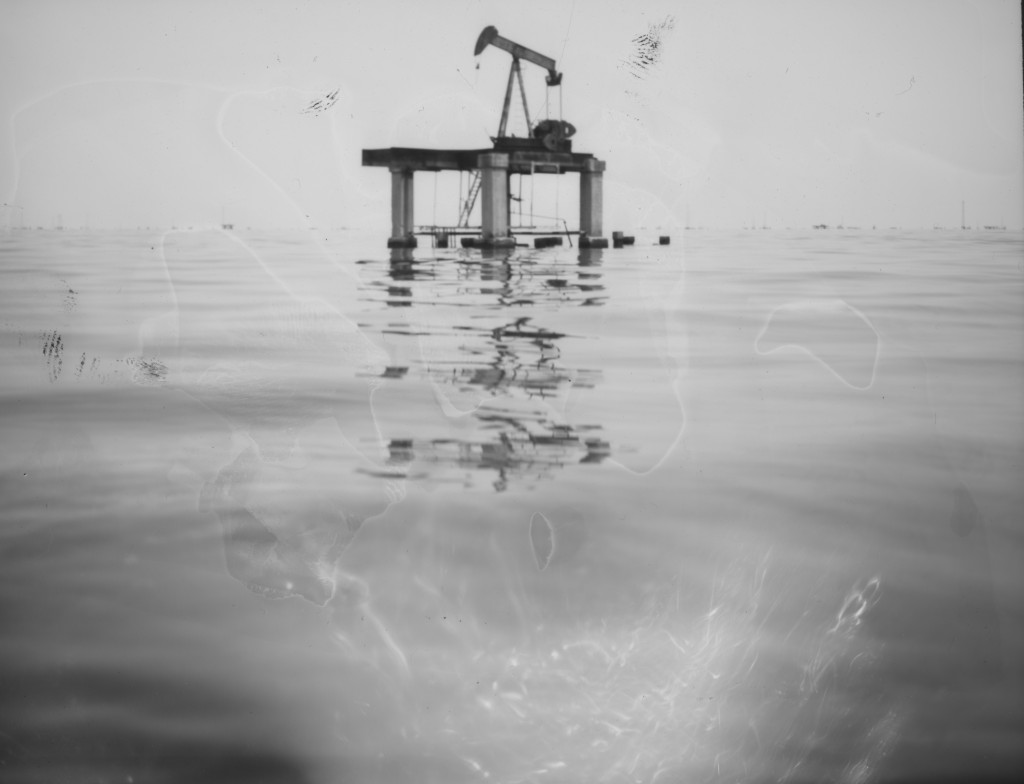 An abandoned oil platform, once run by the state-run company PDVSA, emerges from the oil-contaminated Lake Maracaibo near Cabimas, Venezuela, July 8,