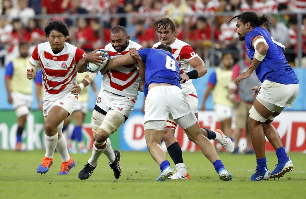 Japan's Michael Leitch runs at Samoa's Jack Lam during the Rugby World Cup Pool A game at City of Toyota Stadium between Japan and Samoa in Tokyo City