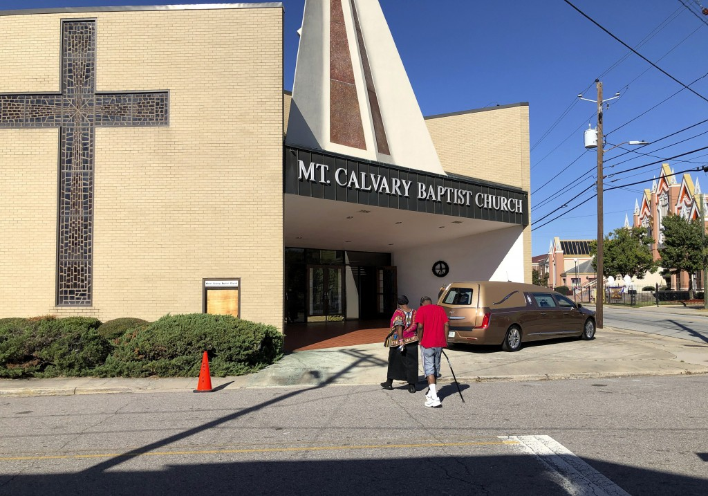 Mourners walk into the visitation for international opera star Jessye Norman at Mt. Calvary Baptist Church in Augusta, Ga., on Friday, Oct. 11, 2019. ...