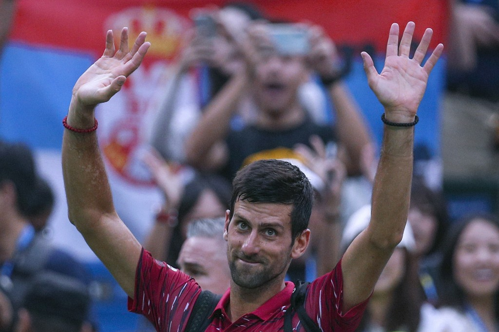 Novak Djokovic of Serbia waves to spectators as he leaves the court after he lost to Stefanos Tsitsipas of Greece in their men's singles quarterfinals
